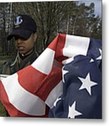 Soldier Unfurls A New Flag For Posting Metal Print by Stocktrek Images