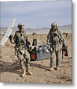 Soldiers Carry An Rq-11 Raven Unmanned Metal Print