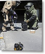 Soldiers Dressed In Bomb Suits Examine Metal Print