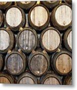 Stacked Oak Barrels In A Winery Metal Print by Marc Volk