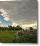 Storm Clouds Gather Over An Abandoned Metal Print