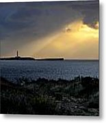 storm light - A morning light iluminates lighthouse through clouds in an amazing landscape Metal Print