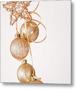 Studio Shot Of Gold Christmas Ornaments Metal Print by Daniel Grill