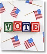 Studio Shot Of Small American Flags And Wooden Blocks With Text Vote Metal Print