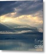 Sunlight And Clouds Over An Alpine Lake Metal Print