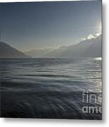 Sunlight Over An Alpine Lake Metal Print
