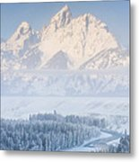 Sunrise Over A Snow-blanketed Landscape Metal Print