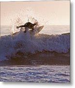 Surfer At Dusk Riding A Wave At Rincon Metal Print