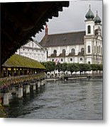 Swans Float Past The Old Town Metal Print by Taylor S. Kennedy
