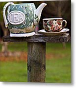 Teapot And Tea Cup On Old Post Metal Print by Garry Gay