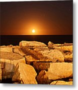 The Moon Rising Behind Rocks Lit Metal Print