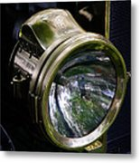 The Old Brass Ford Headlight Metal Print by Steve McKinzie