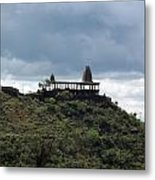 The Structure Of An Abandoned Temple On The Top Of A Green Covered Hill With Blue And White Clouds I Metal Print
