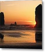 The Sun Sets Over The Sea Stacks Metal Print