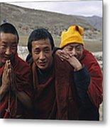 Three Buddhist Lamas In Gansu Province Metal Print by David Edwards