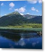 Three People On A Boat In The Lake Metal Print