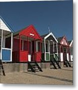 Traditional Beach Huts On The Seafront Metal Print