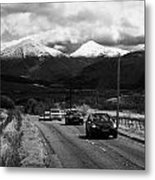 Traffic On A82 Trunk Road Through The Scottish Highlands With Snow Covered Mountains Ben More  Metal Print