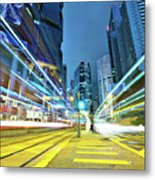 Traffic Trails In City Metal Print by Leung Cho Pan
