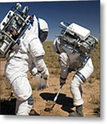 Two Astronauts Collect Soil Samples Metal Print by Stocktrek Images