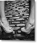 Two Young Women Wearing High Heeled Shoes And Fake Tan On Cobblestones On A Night Out Metal Print by Joe Fox