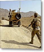 U.s. Army Soldier Moves To His Mrap Metal Print