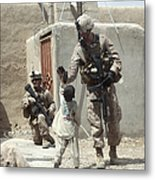 U.s. Marine Gives An Afghan Child Metal Print