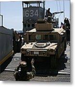 U.s. Marines Load An M1114 Humvee Onto Metal Print