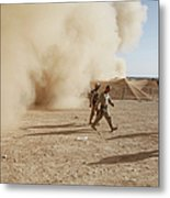 U.s. Marines Walk Away From A Dust Metal Print