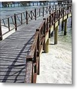 Walkway To Holiday Huts Over Lagoon Metal Print