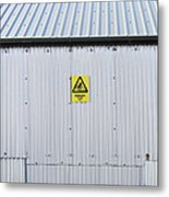 Warning Sign On An Industrial Building Metal Print