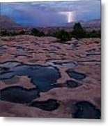 Water Puddled In The Esplanade, A Rock Metal Print