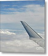 Wings Of Flying Airplane Over Clouds Metal Print