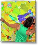 Woman Adjusting A Painting Metal Print by Sami Sarkis