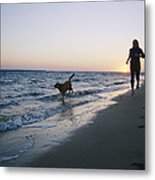 Woman And Dog Running On Beach, Nags Metal Print