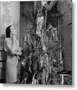 Woman Assisting Man Placing Star On Top Of Christmas Tree, (b&w) Metal Print by George Marks