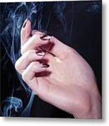 Woman Hand In A Stream Of Smoke Metal Print