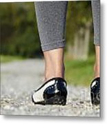 Woman Standing On A Stone Road Metal Print