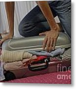 Woman Trying To Close Overflowed Suitcase On Bed Metal Print