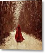 Woman With Red Cape Walking In Woods Metal Print