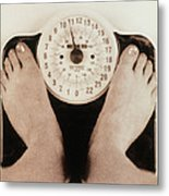 Woman's Feet On A Set Of Weighing Scales Metal Print