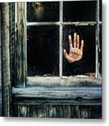 Young Woman Looking Through Hole In Window Metal Print by Jill Battaglia