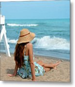 Young Woman Sitting On A Beach Metal Print