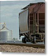 A Lone Grain Hopper Stands Idle On The Tracks Metal Print