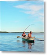 Canoe Fishing  On Blue Lake Metal Print