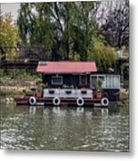 A Raft House Moored To The Shoreline Of Ada Medjica Islet Metal Print