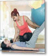 Asian Woman Fitness Coach Teach Her Student For Rubber Ball Exer Metal Print