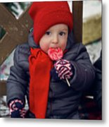 Baby In Red Hat Sits On A Bench In The Street With Candy Metal Print