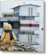 Cheerful Teddy Bear In Knitted Scarf Stand By The Riverside Beside The Port Metal Print