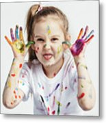 Little Girl Covered In Paint Making Funny Faces. Metal Print